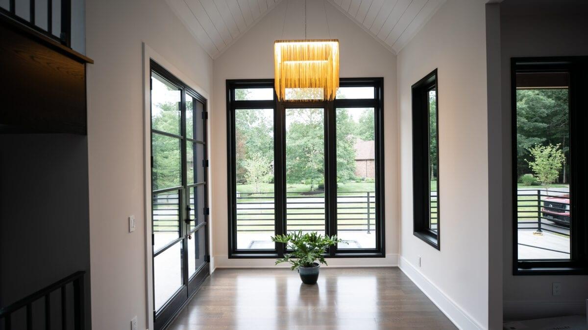 Photo: Custom wood flooring, ceiling and black window trim