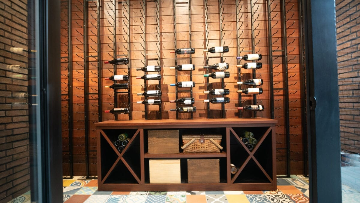 Photo: Wooden Wine Cellar and Wine Cabinet with Mosaic Tile Flooring