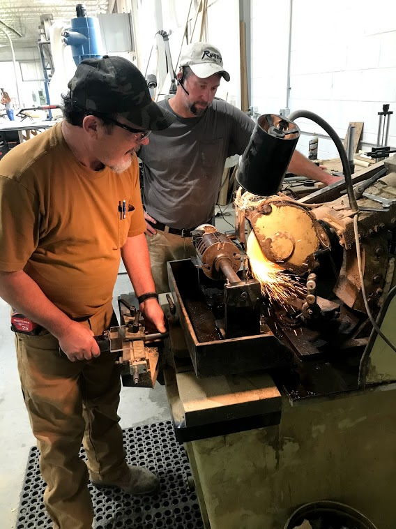 Photo: WVFPC Artisans work with a piece of equipment